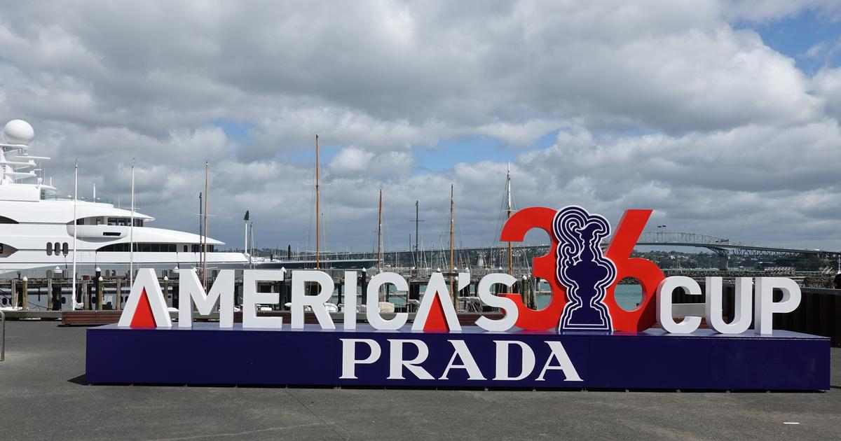 Americas Cup sign at Silo Park Auckland with Westhaven marina and Auckland Harbour Bridge in the background